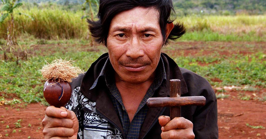 Frank Weaver, Guarani shaman holding cross and rattle, 2006